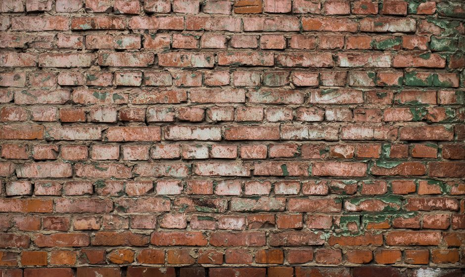 Brick wall representing a barrier