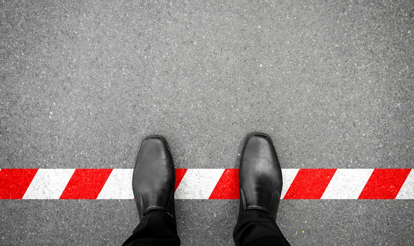 Man standing crossing boarder line